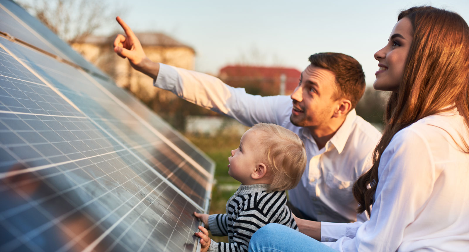 Parents and toddler inspecting solar panel